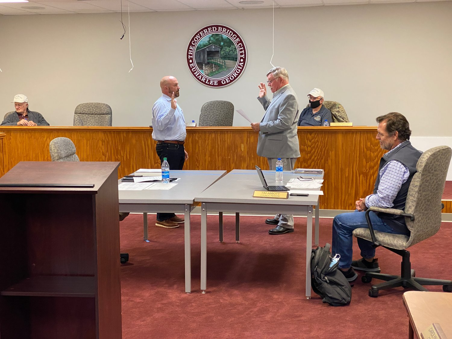 Greg Free, left, is sworn in as a city council member by Euharlee Mayor Steve Worthington at Tuesday evening's public meeting.