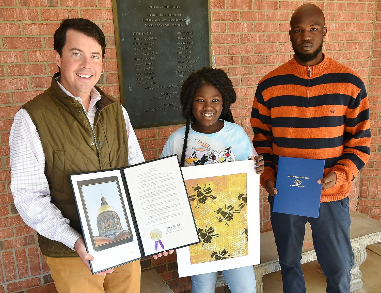 At the Cartersville Unit of the Boys & Girls Club Nov. 18, state Rep. Matthew Gambill, left, presented a resolution to Kamia Smalls, center, recognizing her artwork. Kamia's father, Brandon, also was present for the presentation.