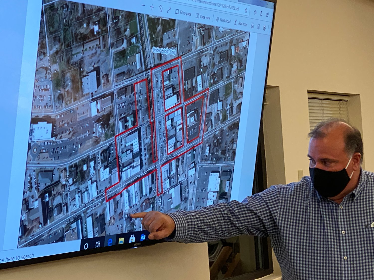 "Cartersville Mayor Matt Santini displays a conceptual map for a proposed downtown ""entertainment district"" prior to Thursday evening's city council meeting."