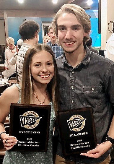 Woodland junior Rylee Evans, left, and Cartersville senior Bill Archer were honored as runners of the year by Wire2Wire Running during a ceremony Thursday in downtown Cartersville.