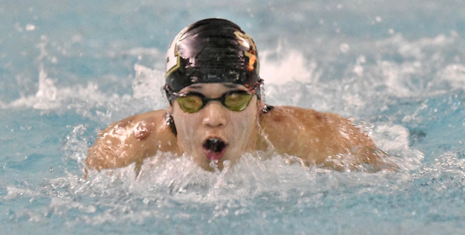 Adairsville's Scott Nguyen competes in the 100-yard butterfly during the Bartow County Championship Saturday at Adairsville. Nguyen won the event, beating out teammate Andy Barnett by less than a second.