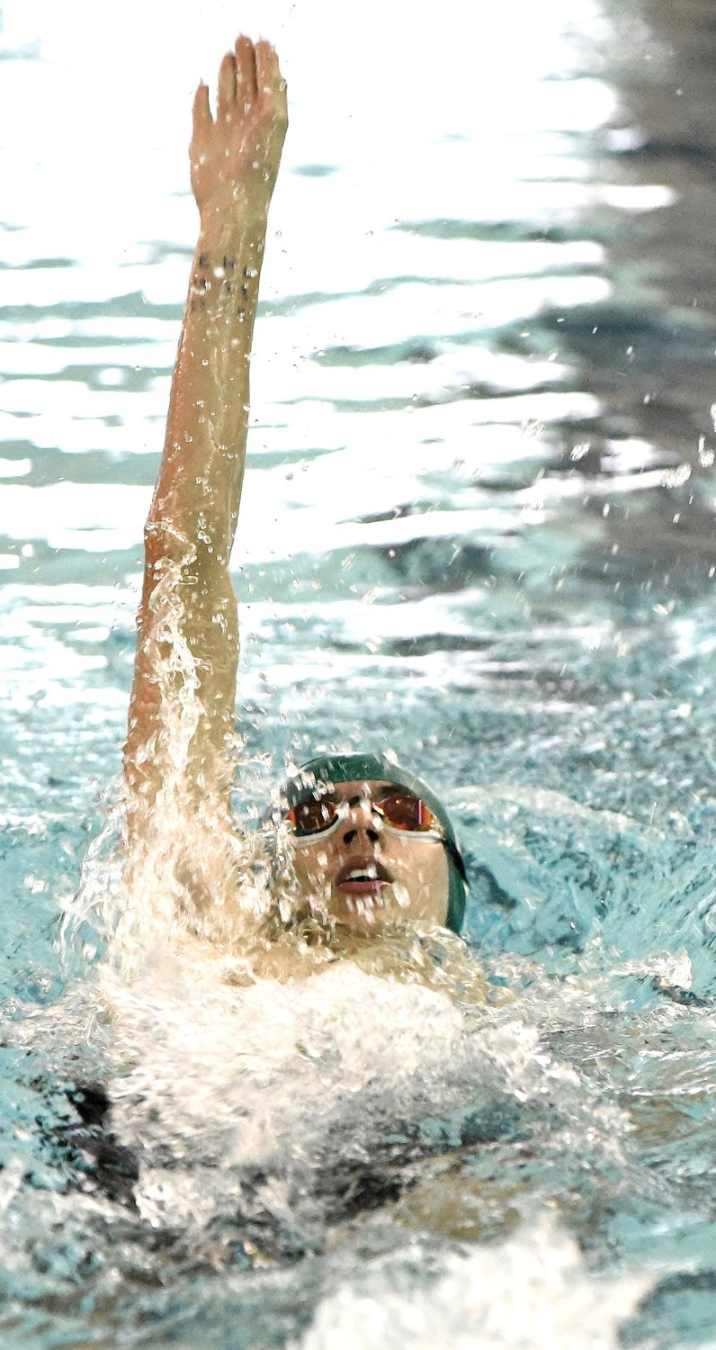 Adairsville's Andy Barnett competes in the 100-yard backstroke during the Bartow County Championship Saturday at Adairsville. Barnett won the event.