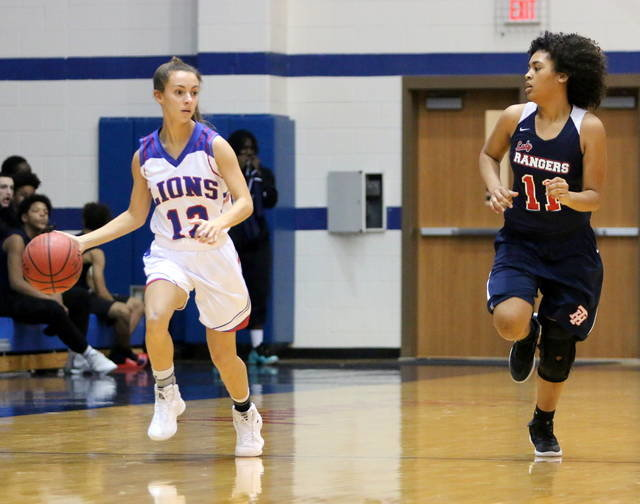 Lady Lion Madi Keel dribbles the ball Saturday when the Lady Lions defeated Tulsa Hale.
