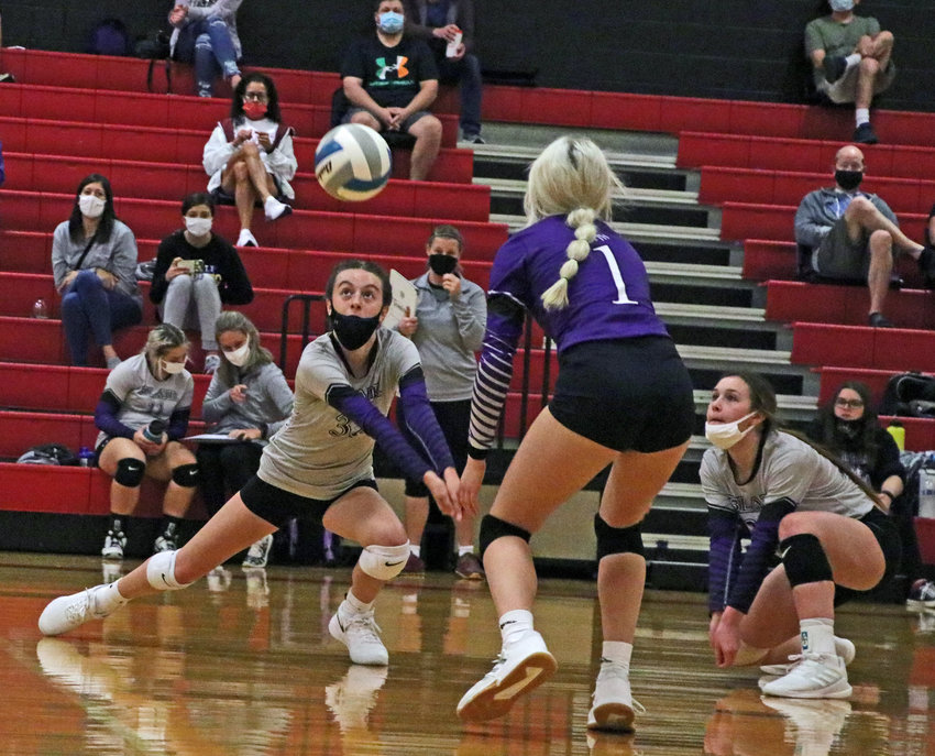 Blair freshman Reece Ewoldt, left, makes a play on the ball alongside Megan McKenon, middle, and Claire Gochanour on Saturday at Elkhorn High School.