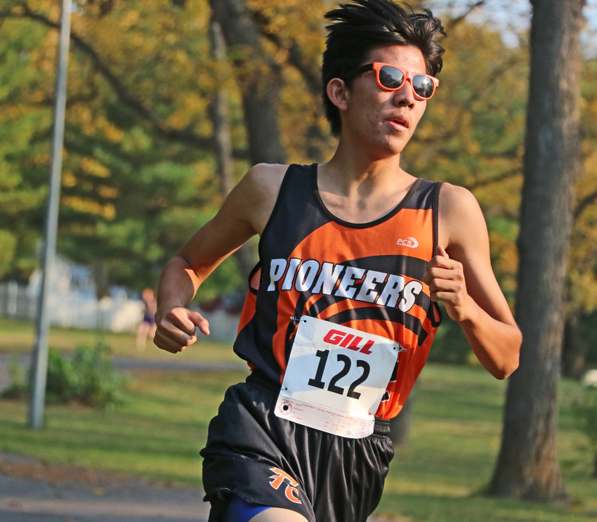 Fort Calhoun's Luke Gustafson runs wearing shades Thursday during the Nebraska Capitol Conference Meet at Walnut Grove Park in Omaha.