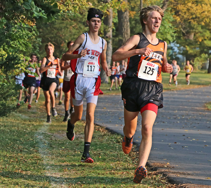 Fort Calhoun's Lance Olberding leads a pack of runners Thursday during the Nebraska Capitol Conerence meet at Walnut Grove Park in Omaha.