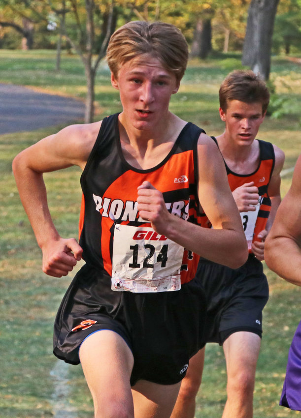 Fort Calhoun's Ely Olberding runs Thursday at Walnut Grove Park in Omaha.