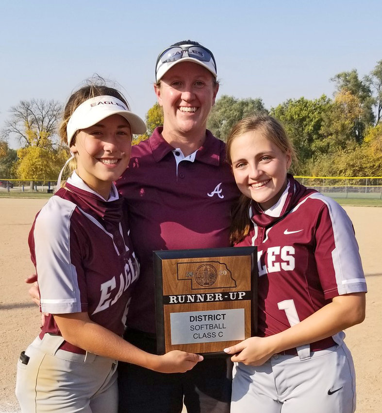 Arlington softball coach Janelle Lorsch, middle, poses for a photo with seniors Kylee Bruning, left, and Lilly Stonehocker, right, on Oct. 9 in Malcolm.