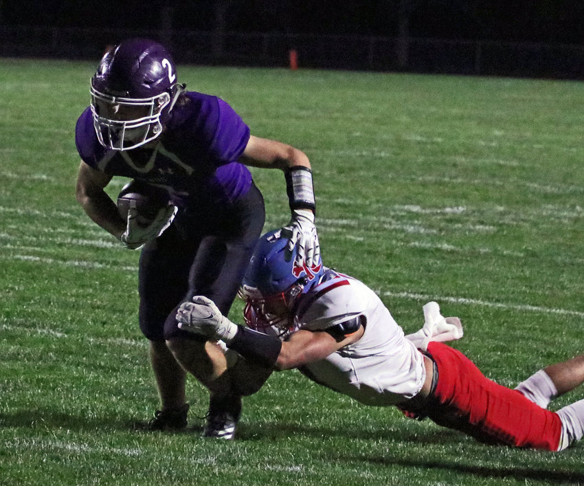 Blair junior Conner O'Neil tries to break a Ralston tackle Friday at Krantz Field.