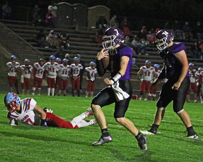 Blair quarterback Morgan Rump, middle, runs into the end zone for one of his two rushing touchdowns Friday at Krantz Field.