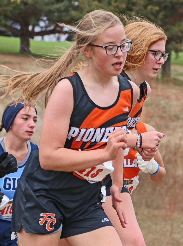 Fort Calhoun's Kaitlyn Thalman, left, and Kylie Perfetti run side-by-side Friday at Kearney Country Club.