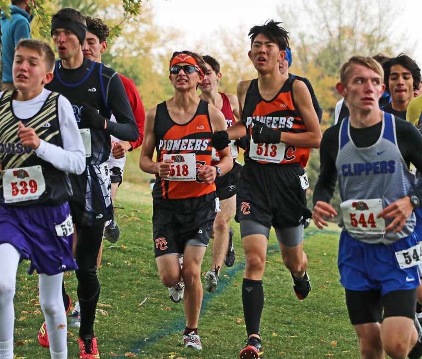 Fort Calhoun's Johnathon Schwarte, middle left, and Luke Gustafson, middle right, run Friday at Kearney Country Club.