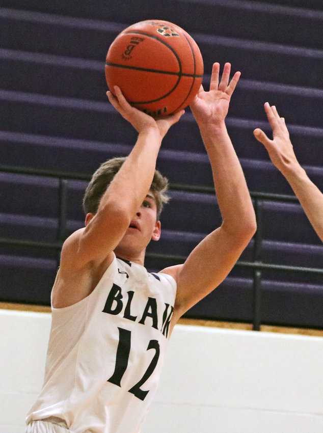 Bears junior Luke Ladwig takes a jump shot Saturday at Blair High School.
