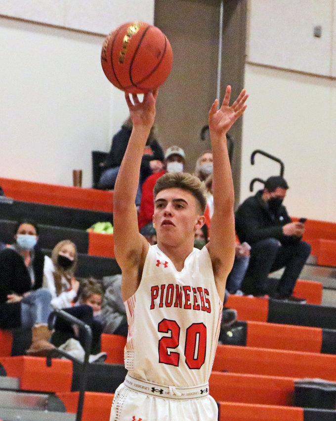 Pioneers sophomore Austin Welchert puts up a shot Monday at Fort Calhoun High School.