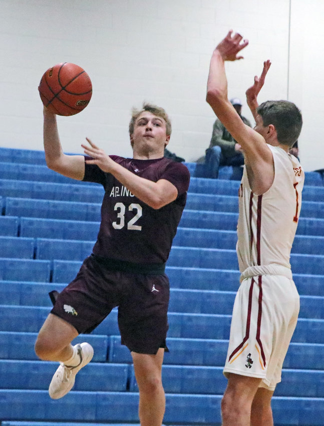 Arlington's Isaac Foust, left, passes the ball around Fairbury's Ethan Smith on Thursday at Lincoln Lutheran.