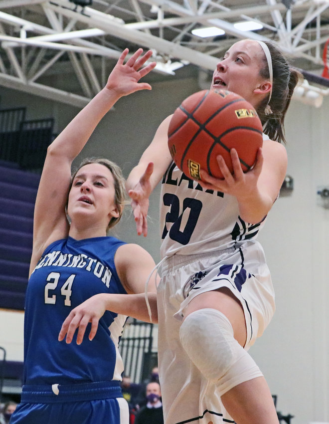 Bears junior Makayla Baughman, right, attempts a layup as Bennington's Taylor Sedlacek defends Saturday at Blair High School.
