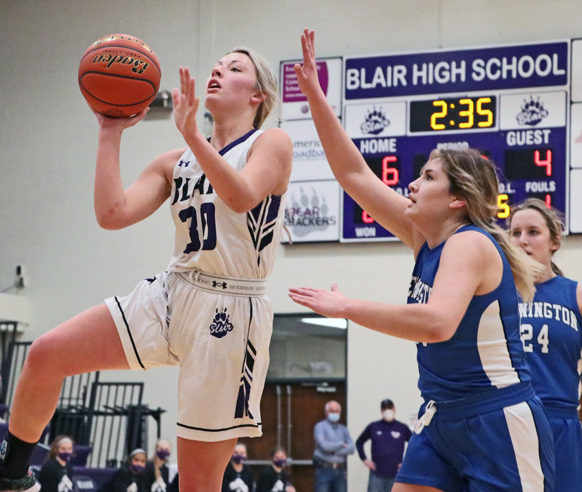 Bears senior Ella Ross, left, shoots a runner in the lane as Bennington's Abby Boyes puts up a hand to challenge it Saturday at Blair High School.