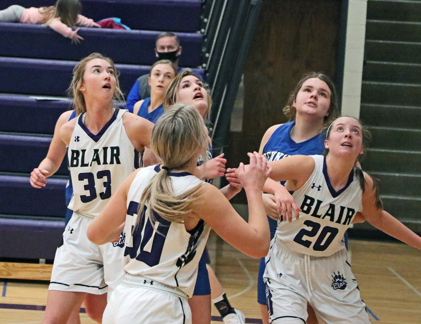 The Bears' Maicy Lourens, from left, Ella Ross and Makayla Baughman get into position for a rebound Saturday at Blair High School.