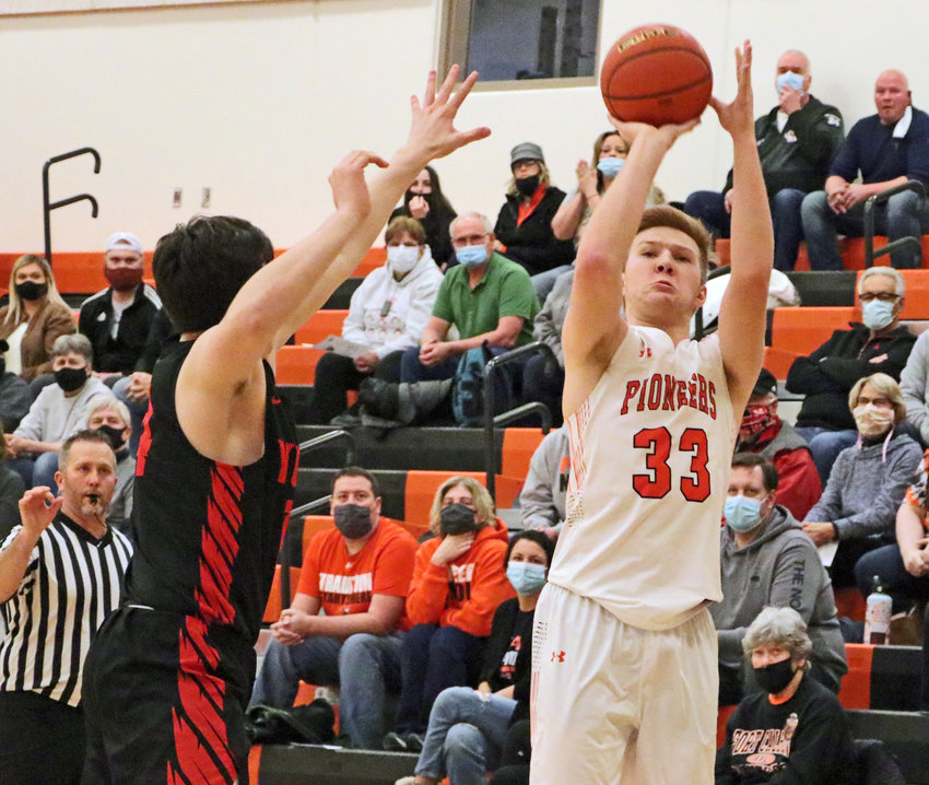 Pioneers junior Carsen Schwarz, right, takes a 3-point shot as Yutan's Drake Trent defends Saturday at Fort Calhoun High School.