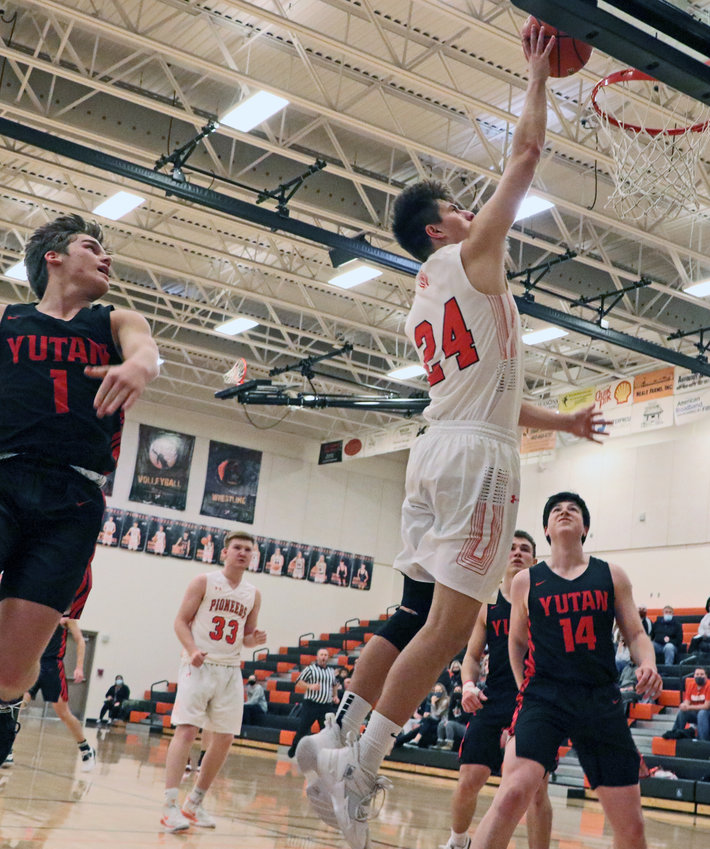 Pioneers senior Brant Hilzendeger scores a layup Saturday at Fort Calhoun High School.
