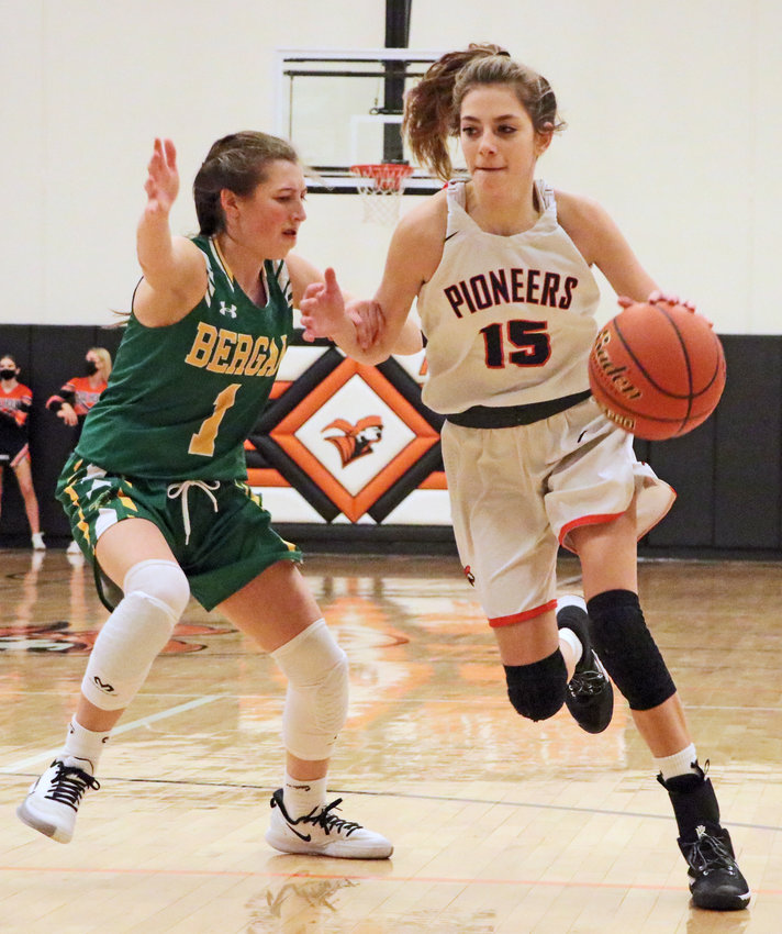 Pioneers junior Tess Skelton, right, dribbles by Fremont Bergan's Summer Bojanski on Thursday at Fort Calhoun High School.