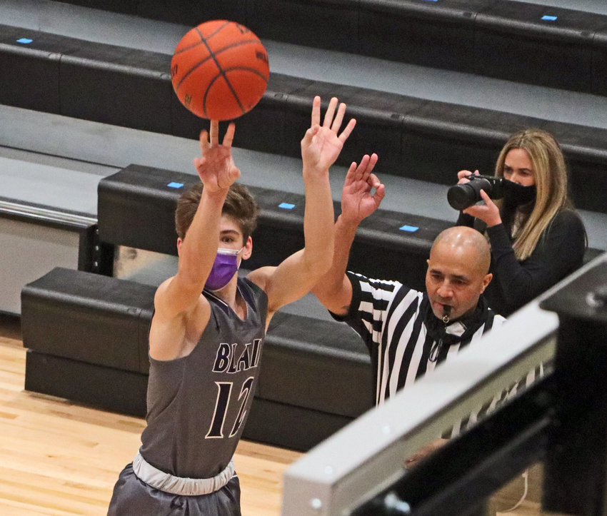 Blair guard Luke Ladwig fires a 3-point shot Tuesday at Elkhorn North High School.