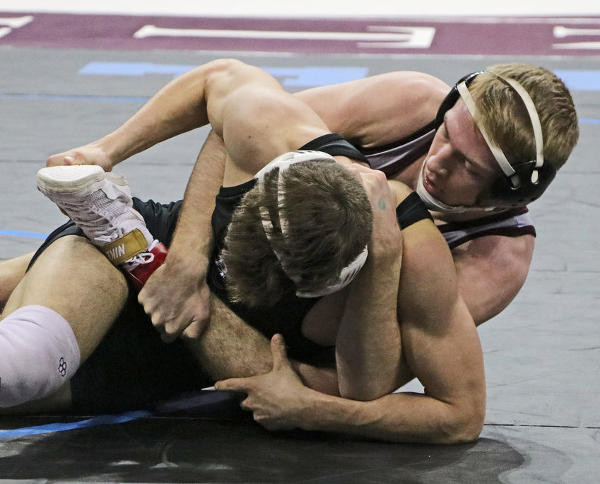 Arlington senior Hunter Gilmore, right, controls his opponent Friday in Omaha.