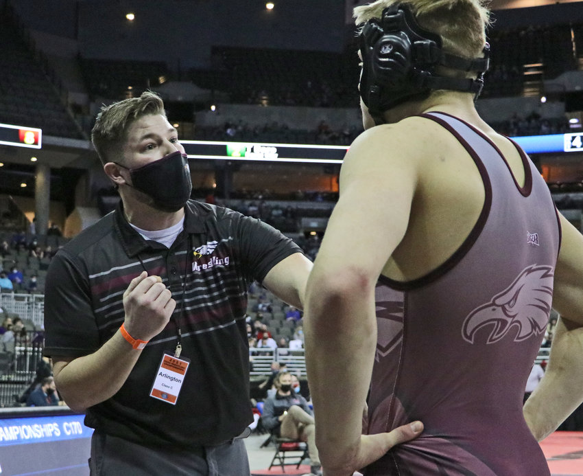 Arlington coach Doug Hart, left, talks strategy with Josh Miller on Friday in Omaha.