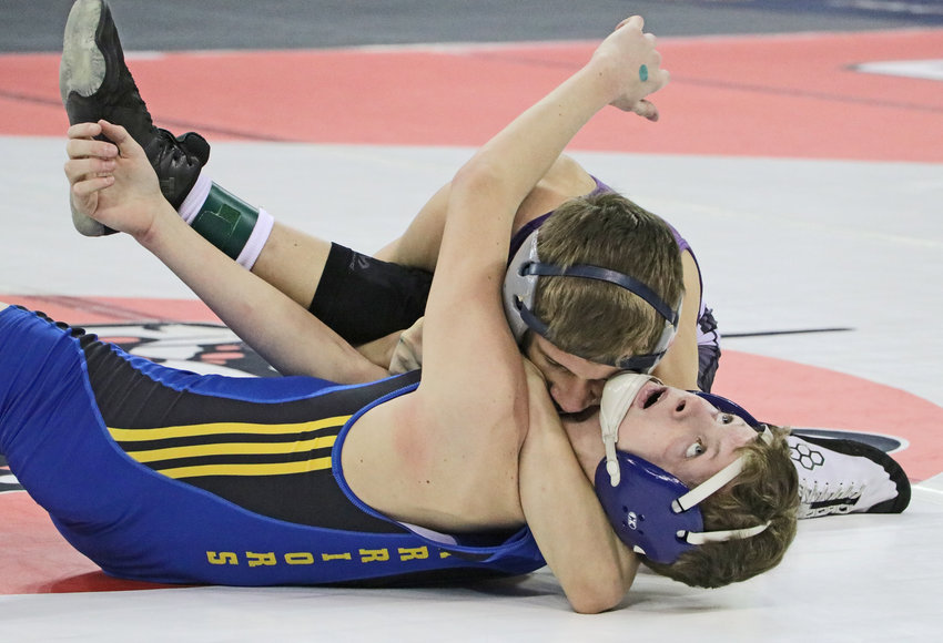Blair 106-pounder Jesse Loges, top, tries to pin Wahoo's Jet Nuckolls to the mat Friday during the NSAA State Wrestling Championships in Omaha.