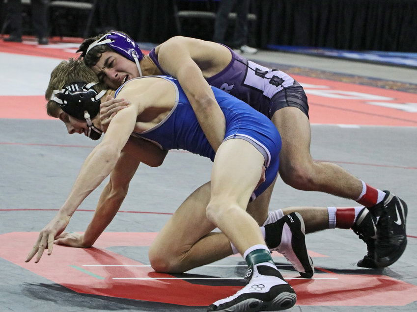 Blair 113-pounder Luke Frost, top, rides Columbus Lakeview's Owen Bargen on Friday during the NSAA Wrestling Championships in Omaha.