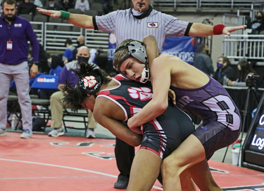 Blair 106-pounder Jesse Loges, right, wrestles Scottsbluff's Joey Canseco on Friday in Omaha.