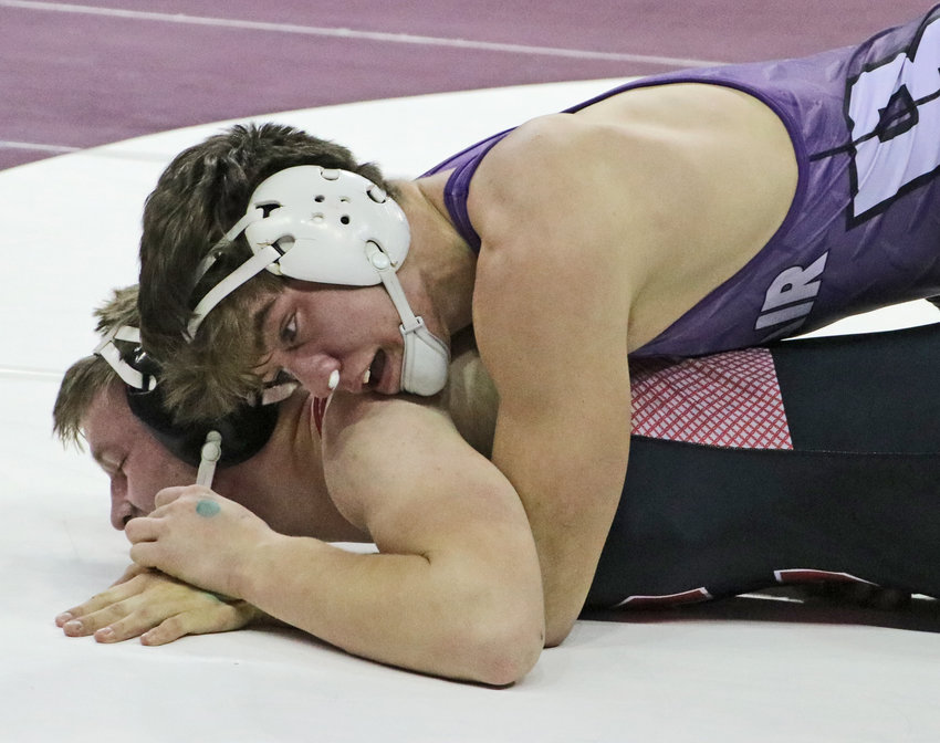 Blair 182-pounder Braden Hanson, top, rides out a first-round win against Kade Waggener of Chadron on Friday during the NSAA State Championships in Omaha.