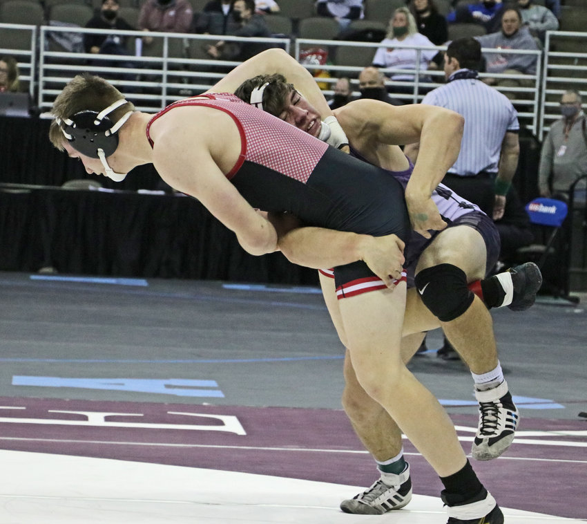 Blair 182-pounder Braden Hanson, right, scores a takedown against McCook's Kade Waggener on Friday in Omaha.
