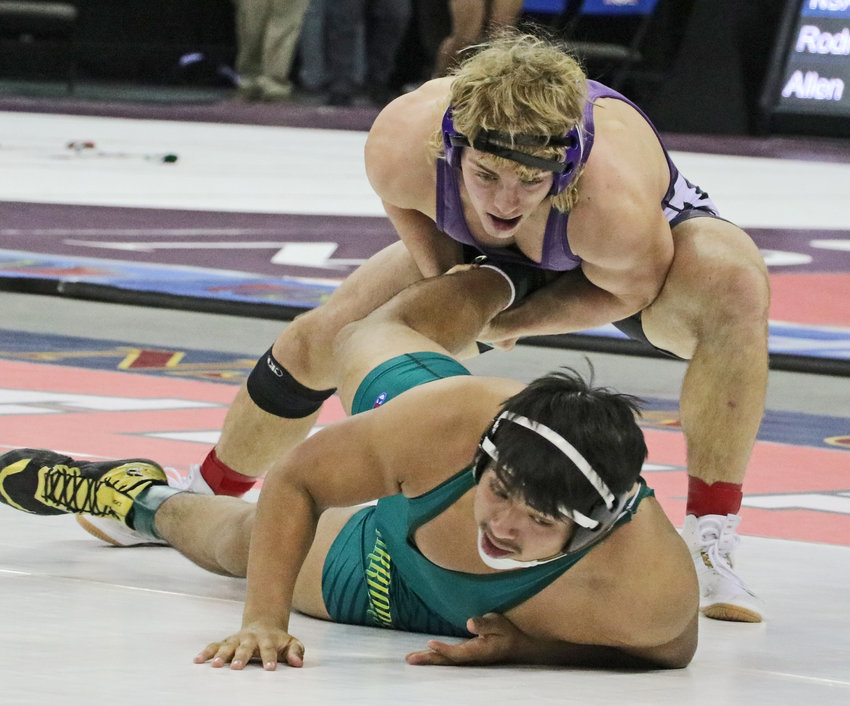 Blair 195-pounder Dex Larsen, back, controls the leg of Schuyler's Gabriel Moyao on Friday during the NSAA State Championships in Omaha.