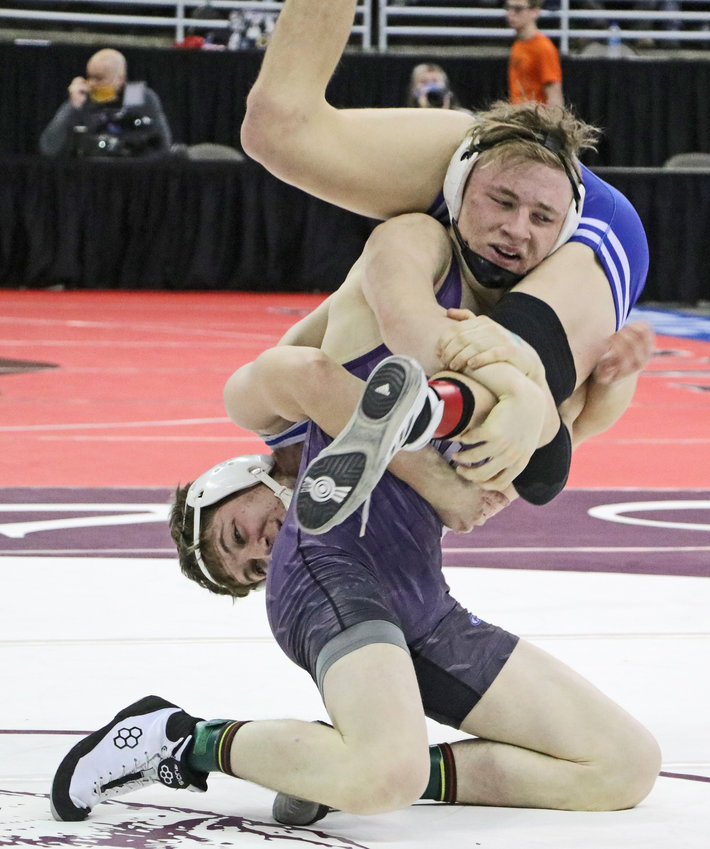Blair 145-pounder Charlie Powers lifts Alliance's Asa Johnson off of the mat Friday during the NSAA Wrestling Championships in Omaha.