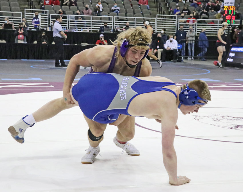 Blair 195-pounder Dex Larsen, top, takes Ashland-Greenwood's Luke Lambert down to the mat Friday in Omaha.