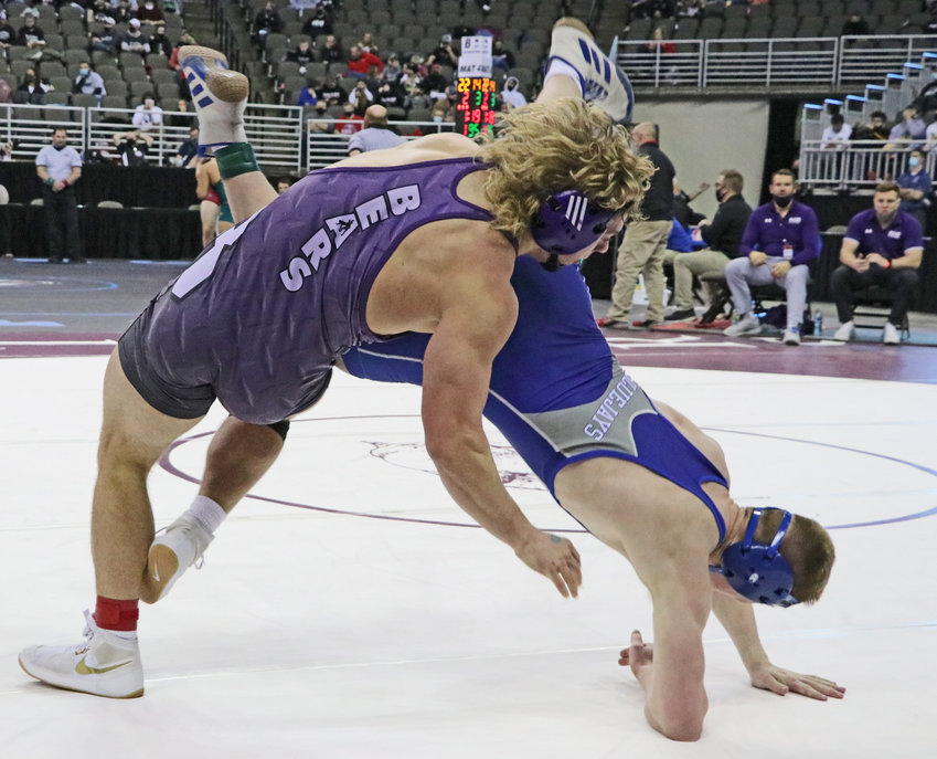 Blair senior Dex Larsen, left, throws Ashland-Greenwood's Luke Lambert to the mat Friday in Omaha.