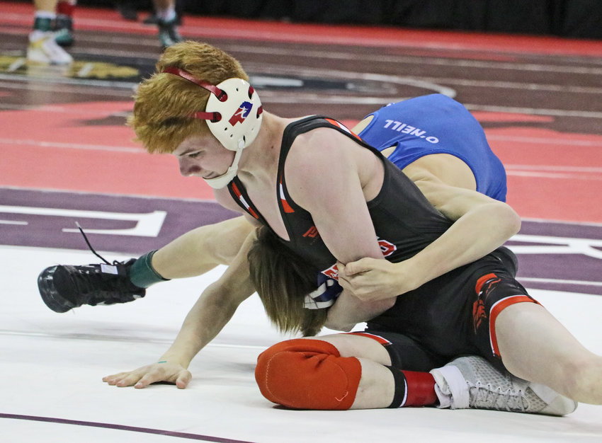 Fort Calhoun 106-pounder Trey McCoy latches onto the head of O'Neill's John Aiden on Friday during the NSAA State Wrestling Championships in Omaha.