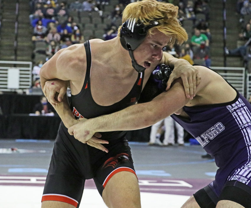 Fort Calhoun 182-pounder Grant Nixon, left, works to escape Milford's Thomas Vance on Friday in Omaha.