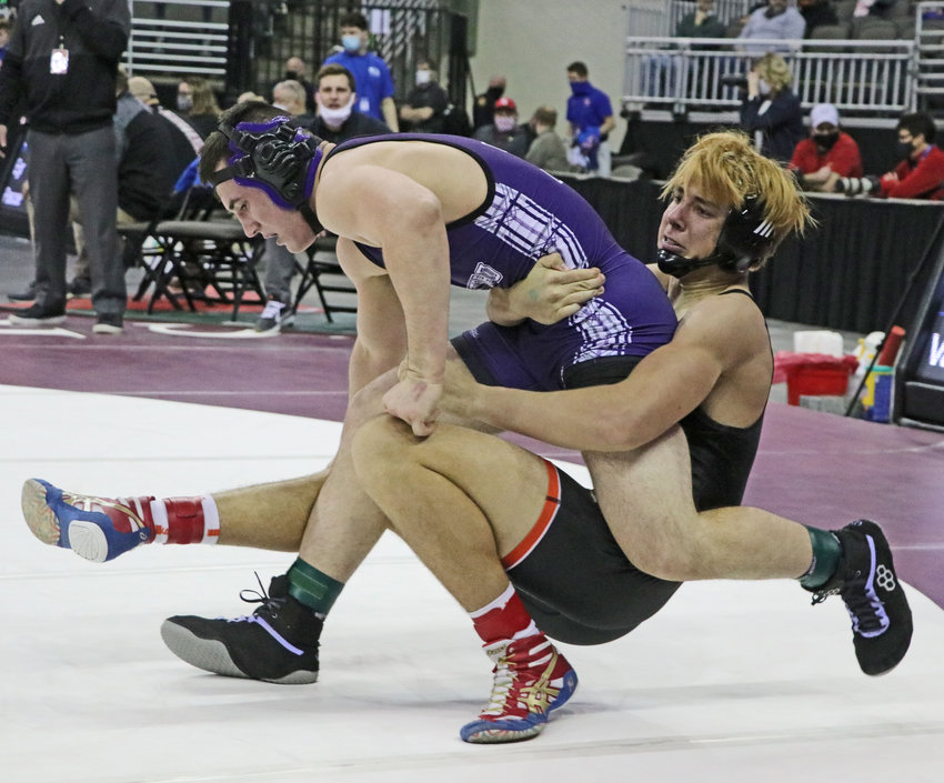 Fort Calhoun 182-pounder Grant Nixon, left, pulls Milford's Thomas Vance to the mat Friday in Omaha.
