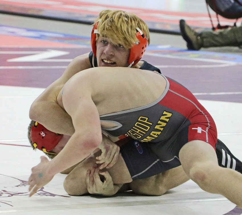 Fort Calhoun 113-pounder Ely Olberding, top, wrestles Friday in Omaha.