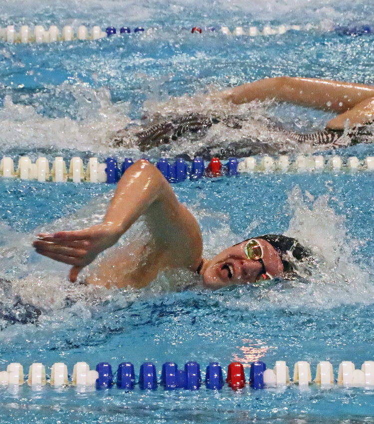 Arlington swimmer Elisabeth Meyer competes Feb. 12 during the HAC Championships in Fremont.