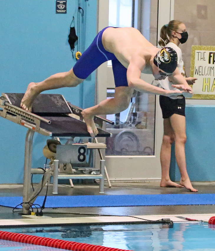 Arlington swimmer Josh Iossi dives in Feb. 12 during the HAC Championships in Fremont.