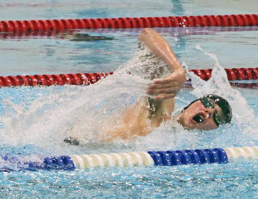 Arlington sophomore Cade Arnett swims for the Fremont 200-yard medley relay team Tuesday at the Fremont Family YMCA.