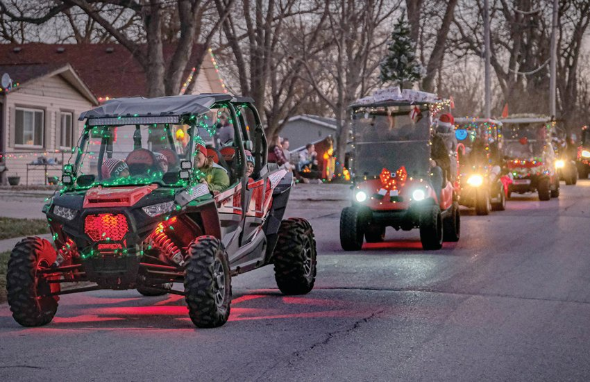 Brightly lit and decorated ATVs and golf carts parade along 10th street in Fort Calhoun during the Christmas Parade of Lights. Though the city had to cancel its annual Christmas in Calhoun event, people were still able to have some holiday cheer from a safe distance with the lighted parade.