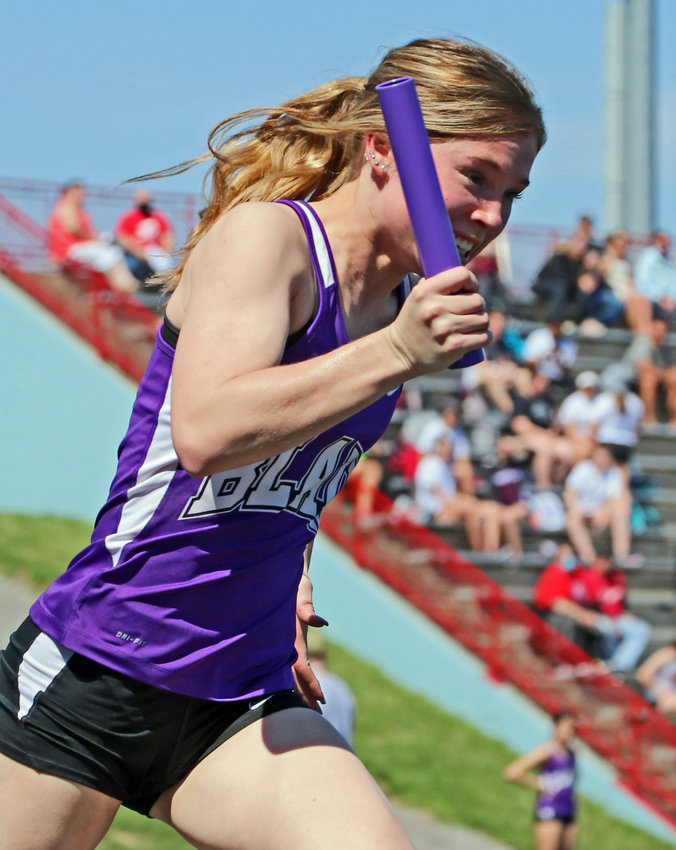 Blair sprinter Reese Beemer competes in a relay Saturday at Ralston High School.