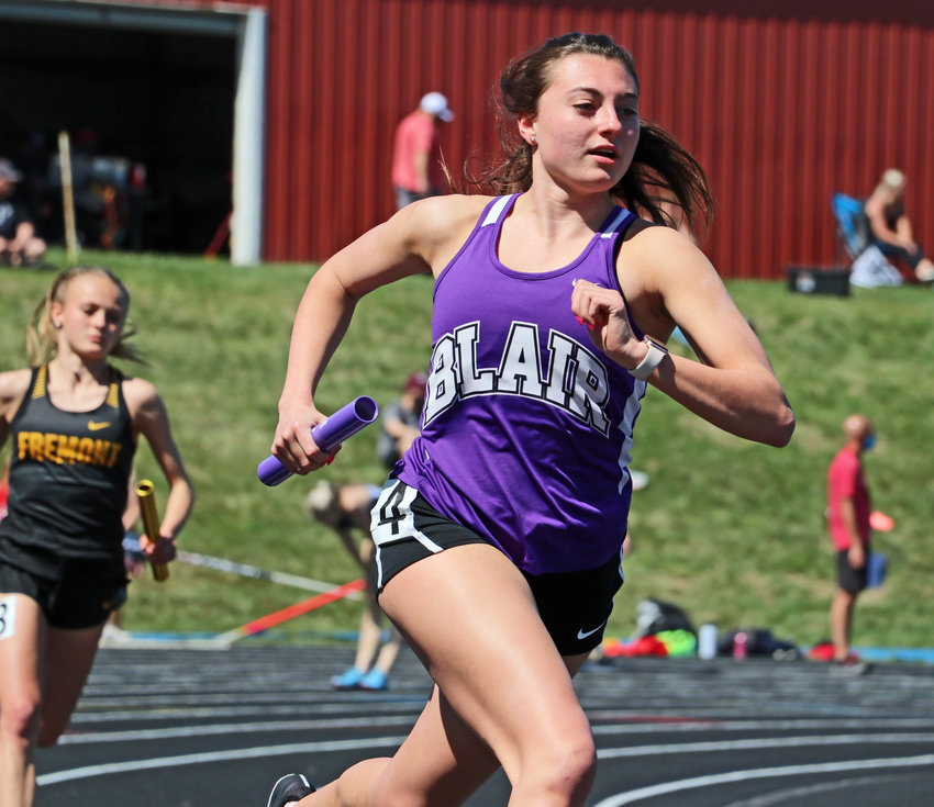 Blair runner Maggie Valasek competes in a relay Saturday at Ralston High School.