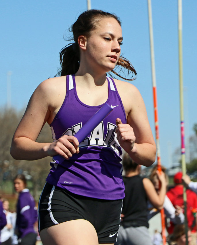 Blair runner Sophia Baedke competes in a relay Saturday at Ralston High School.