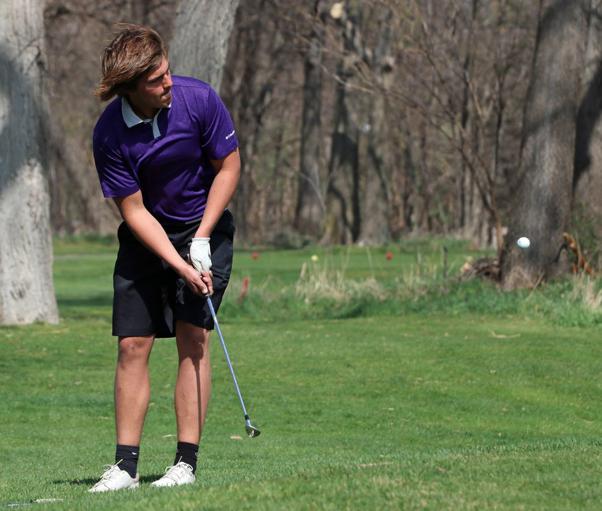 Blair's Jake Stirek chips onto the No. 1 green Tuesday at River Wilds Golf Club.