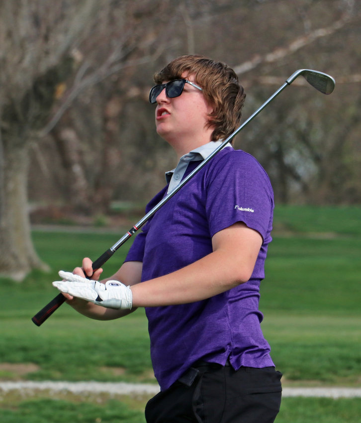 Blair's Landen Oppliger watches his approach shot Tuesday at River Wilds Golf Club.